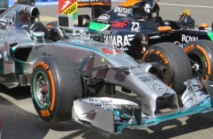 Mercedes and Force India cars in parc ferme.