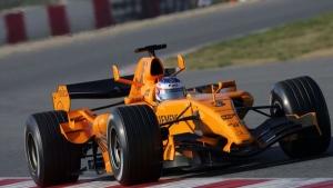 Classic McLaren orange livery on Kimi Raikkonen's car.