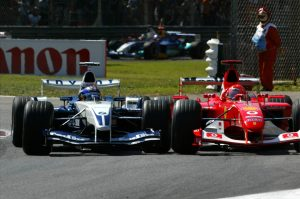 Montoya goes wheel-to-wheel with Michael Schumacher in F1.