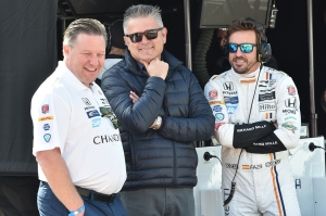 Zak Brown Gil de Ferran and Fernando Alonso share a joke during Indy 500 practice in 2017.