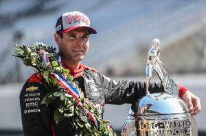 Will Power stands with the Borg Warner trophy after winning the 102nd Indy 500