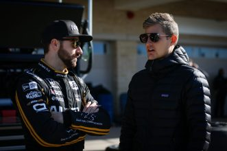 James Hinchcliffe and Marcus Ericcson talk on pit road during IndyCar Spring Training at COTA